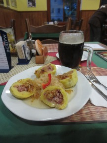 Delicious pork filled potato dumplings with saurkraut